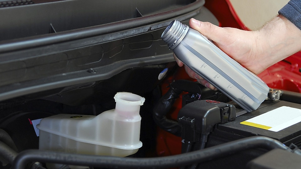 Carefully add Quaker State automatic transmission fluid in small increments