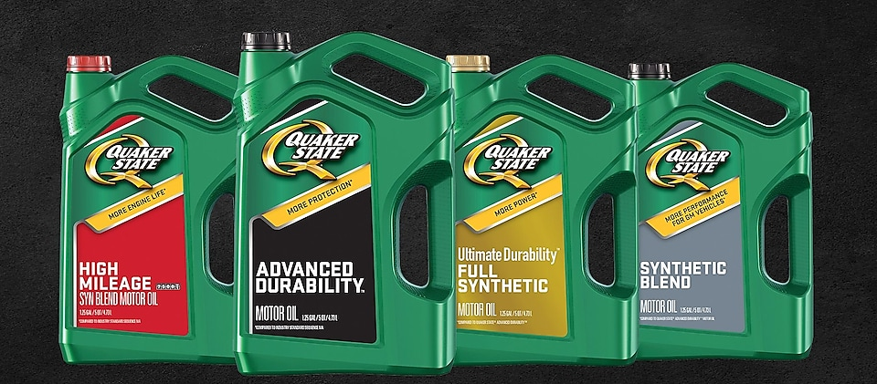 The line of Quaker State Motor Oil in all new green bottles
